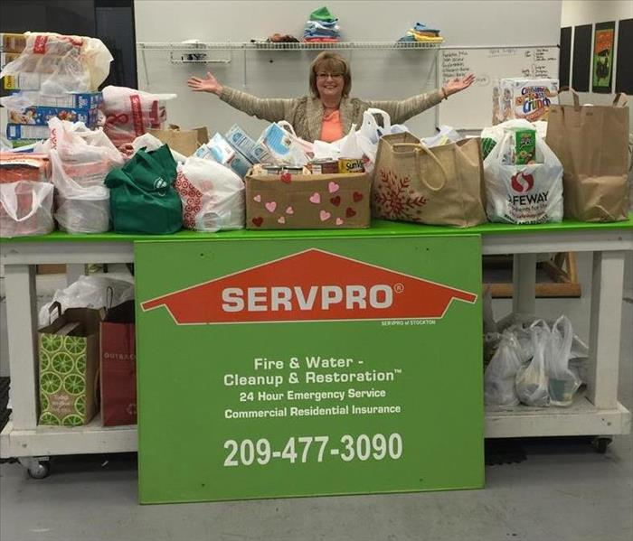Jackie Irrgang of SERVPRO pictured with donated foods.