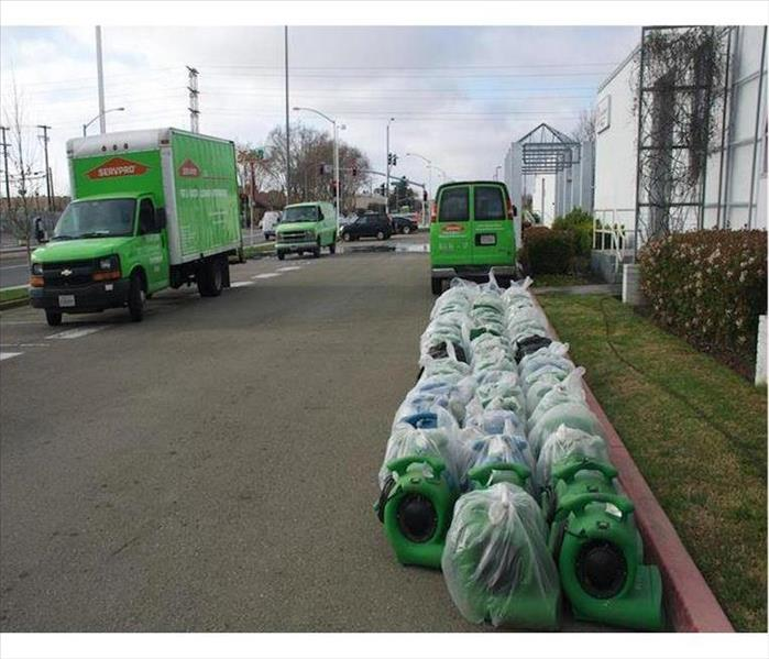 SERVPRO Vehicles and Rows of AIr Movers Outside