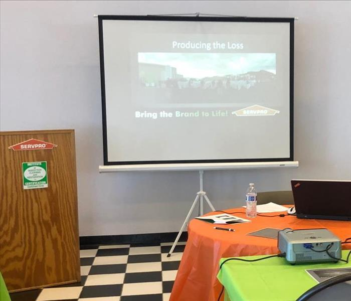 Class Room education by SERVPRO, Projection screen and podium