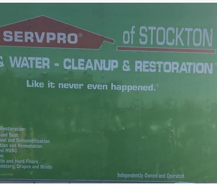 A SERVPRO truck parked in a parking lot.