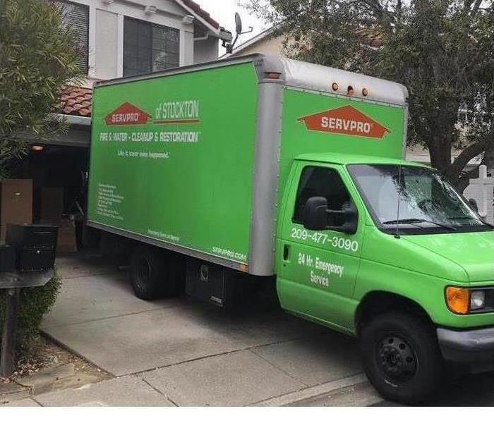One of our box trucks outside a home for a pack out