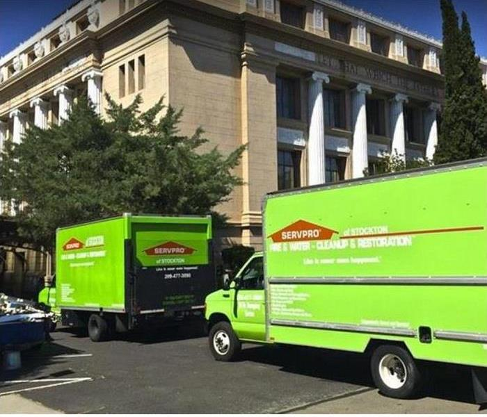 SERVPRO vehicles in front of commercial building